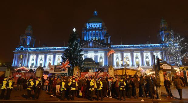 Loyalist protesters gather at Belfast City Hall on the anniversary of a council decision to limit the flying of the Union flag. Pic Arthur Allison.