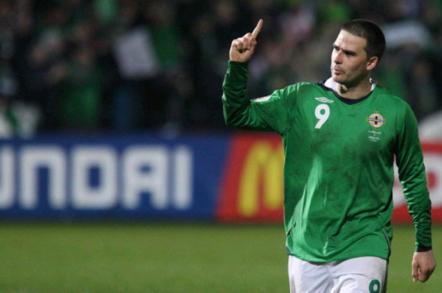 David Healy salutes his stunning goal against Denmark back in 2007 and below