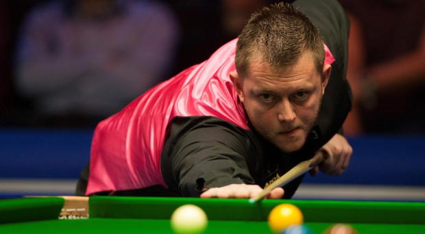 Mark Allen in action against Judd Trump during day nine of the williamhill.com UK Championship at The Barbican Centre, York