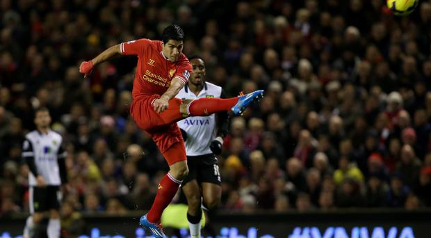LIVERPOOL, ENGLAND - DECEMBER 4: Luis Suarez of Liverpool scores his first goal from a long range effort during the Barclays Premier League match between Liverpool and Norwich City at Anfield on December 4, 2013 in Liverpool, England. (Photo by Jan Kruger/Getty Images)