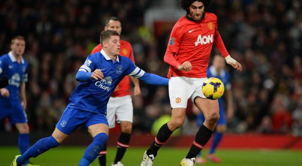Marouane Fellaini of Manchester United competes with Ross Barkley of Everton during the Barclays Premier League match between Manchester United and Everton at Old Trafford