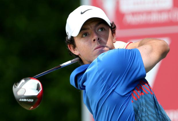Rory McIlroy of Northern Ireland watches his tee shot during his final round at the Australian Open Golf tournament in Sydney, Australia, Sunday, Dec. 1, 2013. McIlroy won by one shot from Australia's Adam Scott. (AP Photo/Rob Griffith)