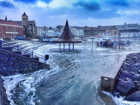 Huge waves turned Portstewart's play park into a swimming pool, as pictured by Darron Mark of Bowline Images