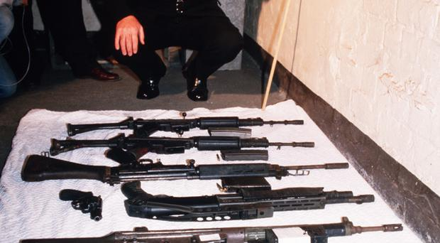9th May 1987: Chief Superintendent Harry Breen shows the guns the 8 IRA men were carrying when they were shot dead by the SAS at Loughgall SAS station a few days earlier
