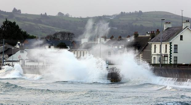 High winds and sea battered the Antrim coast road on December 5, when thousands of homes were left without power in Northern Ireland after gale force winds ripped down trees, power lines and electricity poles.
