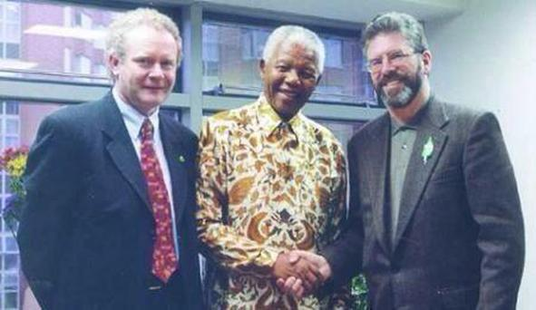 Sinn Fein's Martin McGuinness and Gerry Adams pictured in the 1990s with Nelson Mandela