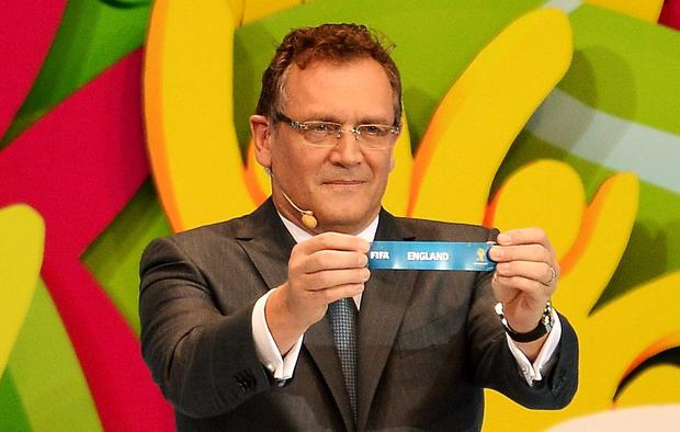 COSTA DO SAUIPE, BRAZIL - DECEMBER 06: FIFA Secretary General Jerome Valcke holds up the name of England during the Final Draw for the 2014 FIFA World Cup Brazil at Costa do Sauipe Resort on December 6, 2013 in Costa do Sauipe, Bahia, Brazil. (Photo by Buda Mendes/Getty Images)