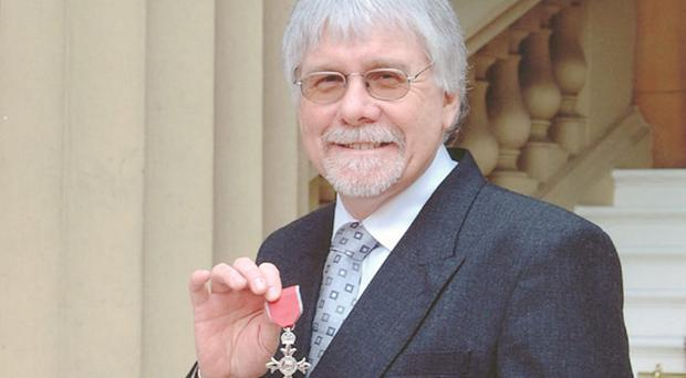 Dr Tom Mason with his MBE