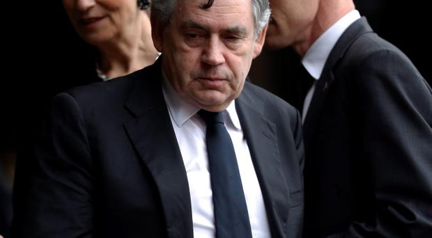 Former British Prime Minister Gordon Brown arrives for the memorial service for former South African president Nelson Mandela at the FNB Stadium in Soweto near Johannesburg, Tuesday, Dec. 10, 2013. (AP Photo/Ben Curtis)