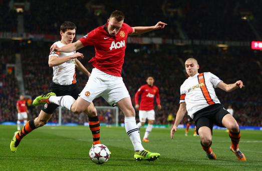 MANCHESTER, ENGLAND - DECEMBER 10: Phil Jones of Manchester United crosses the ball during the UEFA Champions League Group A match between Manchester United and Shakhtar Donetsk at Old Trafford on December 10, 2013 in Manchester, England. (Photo by Michael Steele/Getty Images)