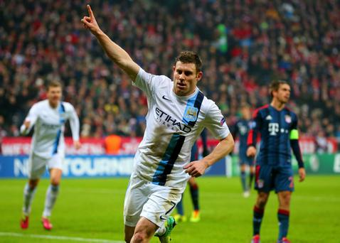 MUNICH, GERMANY - DECEMBER 10: James Milner of Manchester City celebrates scoring their third goal during the UEFA Champions League Group D match between FC Bayern Muenchen and Manchester City at the Allianz Arena December 10, 2013 in Munich, Germany. (Photo by Martin Rose/Bongarts/Getty Images)