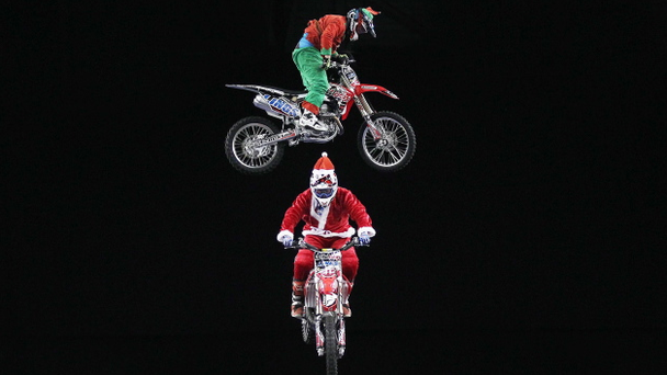 Arenacross Freestyle Motocross riders Dan Whitby, Samson Eaton and Arran Powley dropped in to the Belfast Odyssey Arena on Wednesday dressed as Santa and his two elves