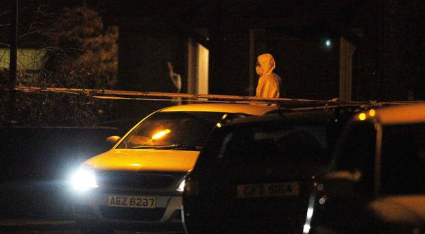 Police at the scene on Ravenhill Court in east Belfast where two bodies were found. Pic Jonathan Porter/Presseye