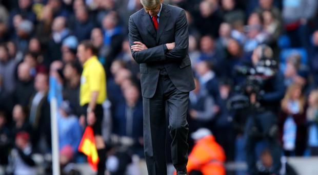 Arsenal manager Arsene Wenger looks frustrated on the touchline during the Barclays Premier League match at The Etihad Stadium, Manchester