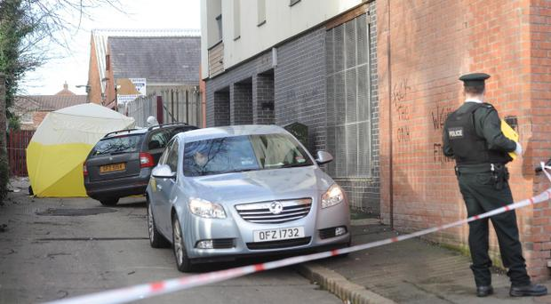 The scene at flats on the Antrim Road in north Belfast where a woman's body was discovered on Sunday morning. Picture Colm Lenaghan/Pacemaker
