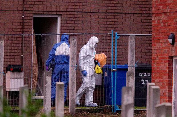 Scene of crime officers at Ravenhill Court in east Belfast where two bodies were found on Friday. Liam McBurney/RAZORPIX