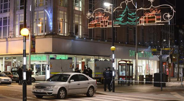 A fire bomb attack on a Belfast shop led to a large security operation in the city centre last Christmas. Pic Arthur Allison