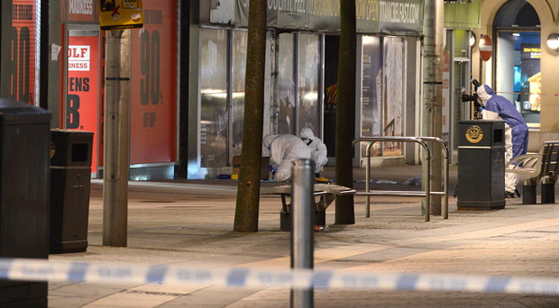 Scene of crime officers after a fire bomb attack on a Belfast shop which led to a large security operation in the city centre. Pic Arthur Allison