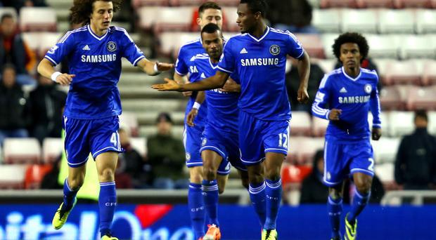 David Luiz and John Obi Mikel of Chelsea high five after the opening goal during the Capital One Cup Quarter-Final match between Sunderland and Chelsea at Stadium of Light on December 17, 2013 in Sunderland, England. (Photo by Jan Kruger/Getty Images)