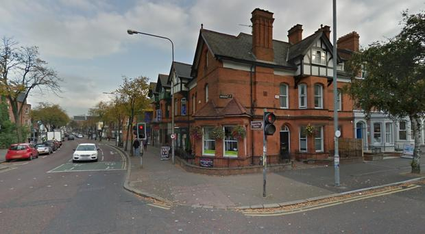 The man was trapped for about 45 minutes on the railings outside Zuni Hairdressing salon, on the corner of Botanic Avenue and University Street in south Belfast. Photo Google Street View.
