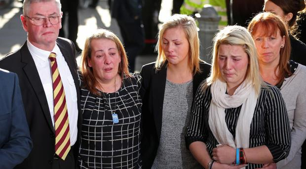 The family of Lee Rigby (L-R) stepfather Ian Rigby, mother Lyn Rigby, sister Sara McClure and fiancee Aimee West talk to reporters at the Old Bailey on December 19, 2013 in London, England. Michael Adebolajo and Michael Adebowale have been found guilty of murdering Fusilier Lee Rigby as he walked back to Woolwich Barracks in south-east London on May 22, 2013. (Photo by Peter Macdiarmid/Getty Images)