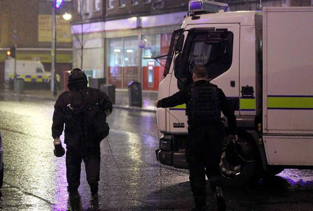 Police investigate a security alert at the corner of Bridge Street and High Street, Belfast last night