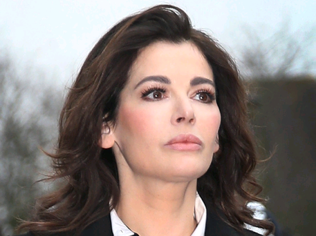 (FILE PHOTO) - Nigella Lawson aides Francesca and Elisabetta Grillo are found not guilty of fraud. ISLEWORTH, ENGLAND - DECEMBER 04: Nigella Lawson arrives at Isleworth Crown Court on December 4, 2013 in Isleworth, England. Italian sisters Francesca and Elisabetta Grillo, who worked as assistants to Nigella Lawson and Charles Saatchi, are accused of defrauding them of over £300,000. (Photo by Peter Macdiarmid/Getty Images)