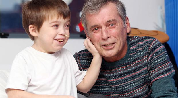 John Morrow (7) from Millisle, Co. Down pictured with his father Sidney