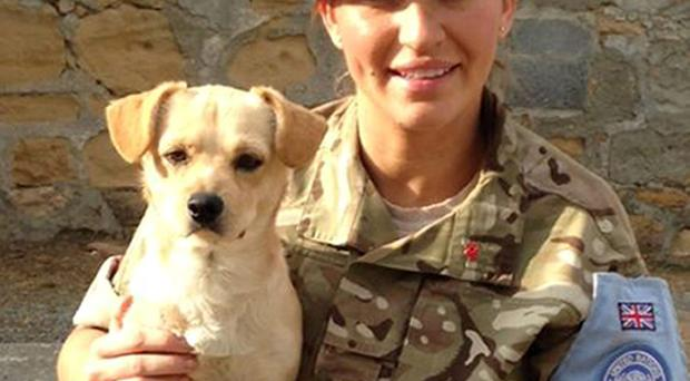 Undated family handout photo of Royal Military Police Sergeant Ashley Rodden in Cyprus with stray dog Bob, who she rescued and flew home to Co Antrim while serving overseas.