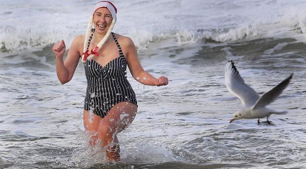 Hardy swimmers take part in the Santa Splash at Portrush to raise funds and awareness for Cardiac Risk in the young