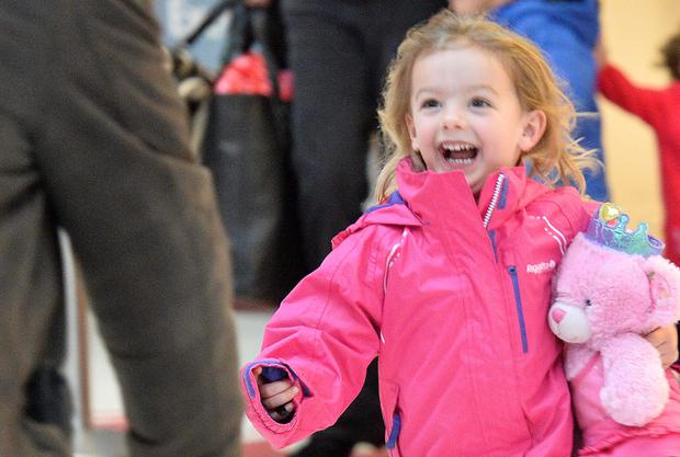 Erin Grahamfrom Sheffield runs to meet granda Robert at Belfast City Airport as she arrives home for Christmas. Photograph:Stephen Hamilton/Presseye.com