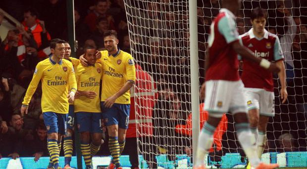Arsenal's Theo Walcott celebrates his second goal during the Barclays Premier League match at Upton Park, London.