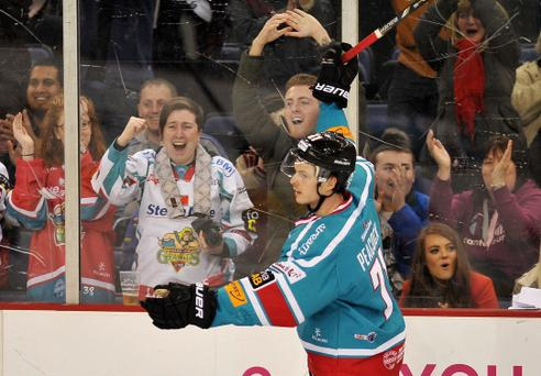 27/12/13: Craig Peacock of the Belfast Giants celebrates after scoring the forth and final goal in the 4-1 win against the Breahead Clan during the Elite League game at the Odyssey Arena, Belfast.