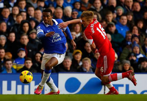 James Ward-Prowse of Southampton tangles with Sylvain Distin of Everton during the Barclays Premier League match at Goodison Park
