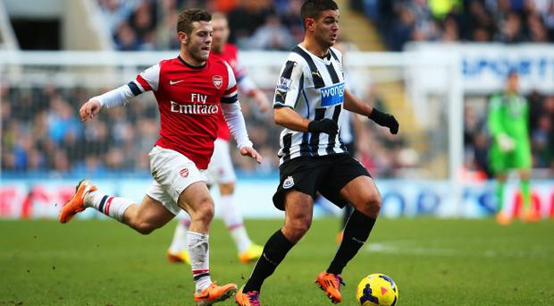 Hatem Ben Arfa of Newcastle United is closed down by Jack Wilshere of Arsenal during the Barclays Premier League match at St James' Park