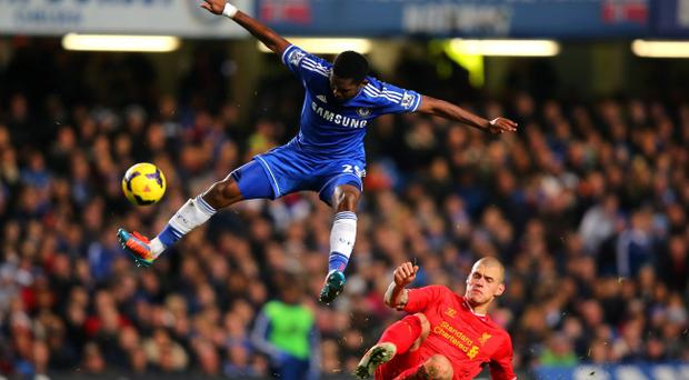 Samuel Eto'o of Chelsea controls the ball under pressure from Martin Skrtel of Liverpool during the Barclays Premier League match