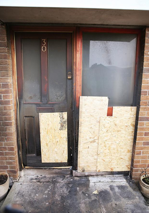 Two people used a ladder to escape from a house in Mackey Street in the early hours of Sunday morning after neighbours alerted them about a fire at the front door of the building