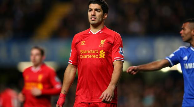 LONDON, ENGLAND - DECEMBER 29: Luis Suarez of Liverpool looks on during the Barclays Premier League match between Chelsea and Liverpool at Stamford Bridge on December 29, 2013 in London, England. (Photo by Julian Finney/Getty Images)