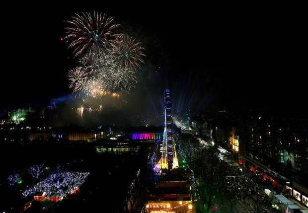 Fireworks light up the sky over Edinburgh Castle during the New Year Edinburgh Hogmanay celebrations in Scotland. PRESS ASSOCIATION Photo. Picture date: Wednesday January 1, 2014. See PA story SOCIAL NYE. Photo credit should read: David Cheskin/PA Wire
