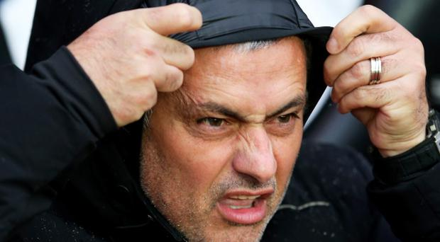 SOUTHAMPTON, ENGLAND - JANUARY 01: Jose Mourinho the Chelsea manager braves the elements during the Barclays Premier League match between Southampton and Chelsea at St Mary's Stadium on January 1, 2014 in Southampton, England. (Photo by Warren Little/Getty Images)