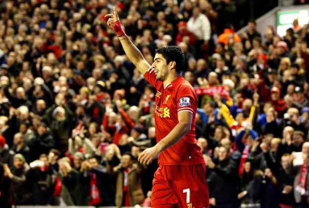Liverpool's Luis Suarez celebrates his goal during the Barclays Premier League match at Anfield, Liverpool