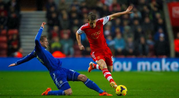 Chelsea's Andre Schurrle (left) and Southampton's Steven Davis during the Barclays Premier League match at St Mary's Southampton