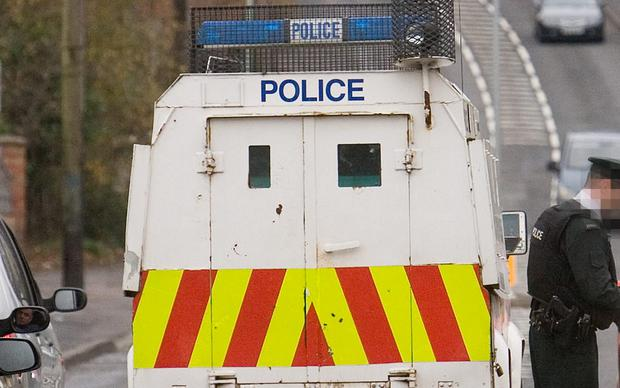 A police officer has been attacked with a knife as he attended a report of an assault in Belfast