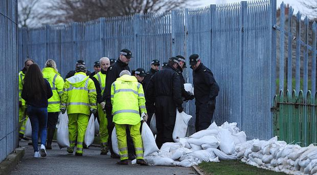 Sandbags are piled up in Victoria Park, Sydenham, east Belfast, where a tidal surge is expected to bring flooding on Friday. Picture By: Arthur Allison