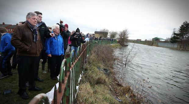 First Minister Peter Robinson visits Victoria Park in east Belfast as the Connswater River threatens to overflow
