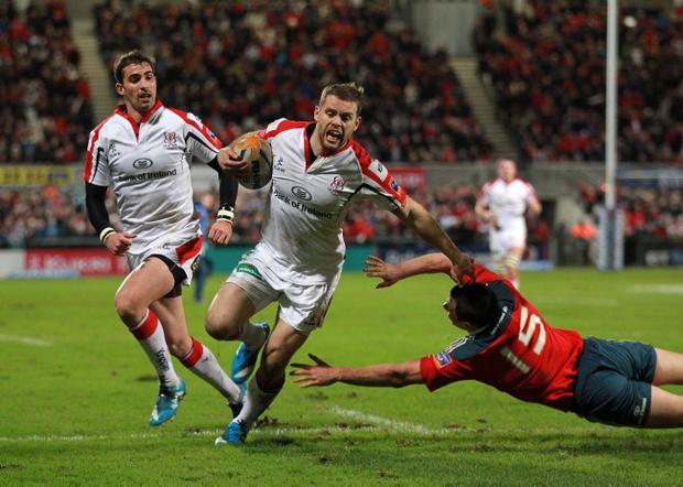 RABO DIRECT PRO 12: ULSTER V MUNSTER. RAVENHILL, BELFAST. Munster's Felix Jones misses the tackle to let Darren Cave in for an Ulster try
