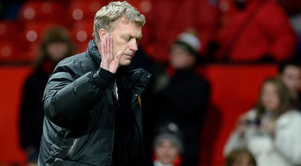 Manchester United manager David Moyes shows is dejection as he leaves the pitch after their 2-1 defeat against Swansea City during the FA Cup Third Round match at Old Trafford, Manchester.