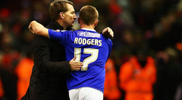 LIVERPOOL, ENGLAND - JANUARY 05: Liverpool manager Brendan Rodgers hugs son Anton Rodgers of Oldham after the Budweiser FA Cup third round match between Liverpool and Oldham Athletic at Anfield on January 5, 2014 in Liverpool, England. (Photo by Clive Mason/Getty Images)