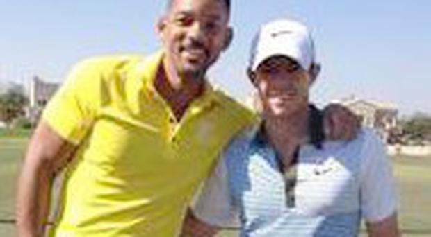 Rory McIlroy with Will Smith on a golf course in Dubai