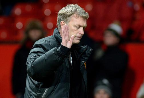 Manchester United manager David Moyes shows is dejection as he leaves the pitch after their 2-1 defeat against Swansea City during the FA Cup Third Round match at Old Trafford, Manchester